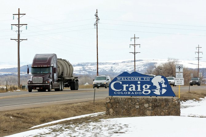 A semi-truck leads a line of vehicles out of Craig on Thursday eastbound on U.S. Highway 40. For several days, motorists have detoured through Craig because of a rock slide closing parts of I-70. The detour has increased business for local gas stations and hotels.