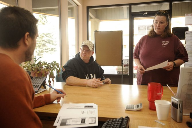 Colorado Workforce Center employment specialist Matt McLeod, left, assists Phippsburg residents Kavin and Trudy Pauley with finding work Thursday. Kavin Pauley said he was laid off Thursday and was looking for any job to support his three kids.