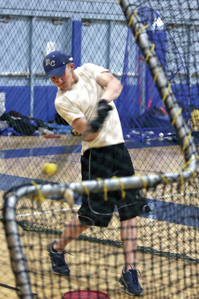 Senior Paul Collins works on his batting skills during baseball practice Friday in the Moffat County High School gymnasium. The team will play at 2 p.m. today in Rifle for a season-opening doubleheader.