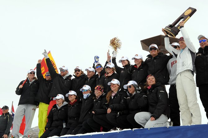 University of Denver's Antje Maempel, four-time NCAA individual champion, lifts the NCAA team championship trophy Saturday in Steamboat Springs. DU won the championship for the 21st time and the third time in three years.