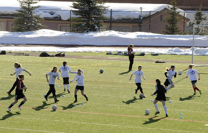 Steamboat Springs High School girls soccer players practice Friday afternoon. They play today at 11 a.m. against Glenwood Springs.