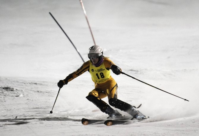 University of Colorado alpine skier Katie Hartman skies down the face of Howelsen Hill on Friday night during the NCAA Championships slalom event.