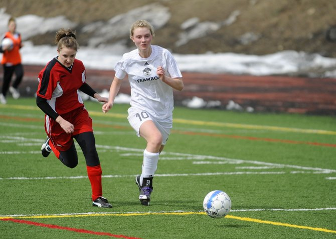 Steamboat Springs High School senior Kiersten Henry chases the ball during the first half of Saturday's match against Glenwood Springs. Steamboat won, 2-1.