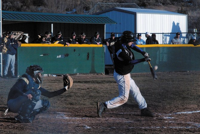 Moffat County High School's Dylon Camilletti connects during the second game of a Saturday season-opening doubleheader in Rifle. Camilletti, a junior, knocked in the game winning run in the second game as the Bulldogs won, 10-9, to split the series.