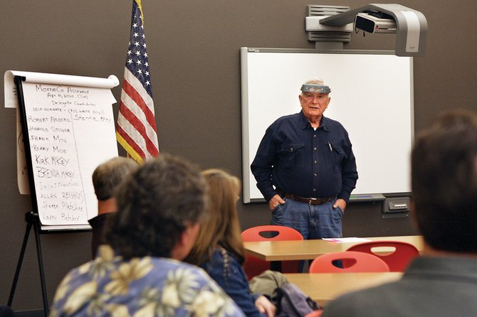 Bob Aaberg, Republican Precinct 7 chairman, addresses residents in his caucus Tuesday night at the Craig Middle School library. Party members in 13 Republican precincts nominated delegates to attend the Republican county assembly April 10.