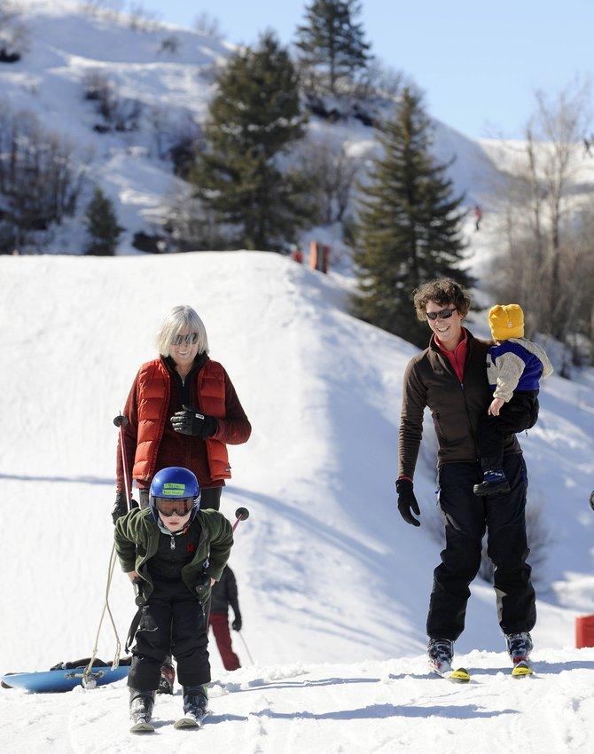 Steamboat Springs resident Linda Kakela watches her visiting grandson Beck, 4, ski at Howelsen Hill on Tuesday with her daughter Annie Kakela, who is holding her daughter Anja, 1. City Council gave final approval Tuesday night to using $250,000 as seed money to pursue several million dollars in grants and donations for improvements at Howelsen.