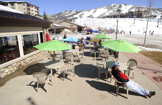 Jerry Villanova, of New York, relaxes Tuesday on the patio of Vintage Bar at the base of Steamboat Ski Area. Base area officials are planning how to best use money to expand the promenade.