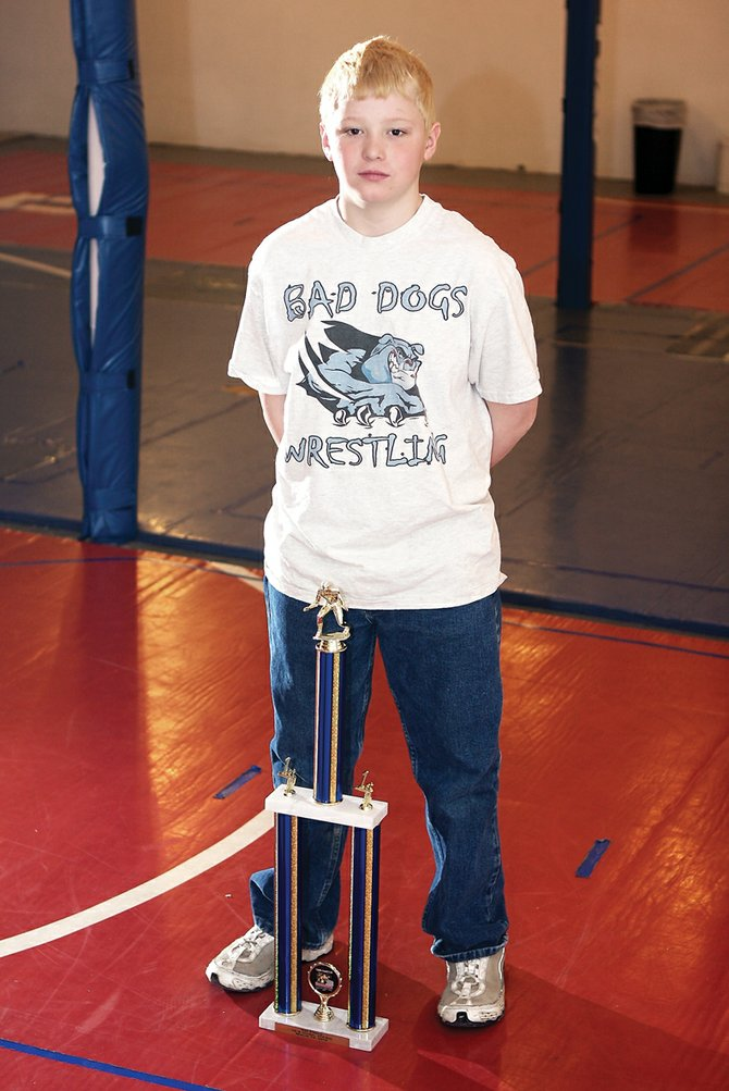 Deven Mosman, 10, of the Craig Bad Dogs, will try to claim the Triple Crown this weekend in Denver. To win the Triple Crown, a youth wrestler needs to have three national tournament wins. Mosman has two.