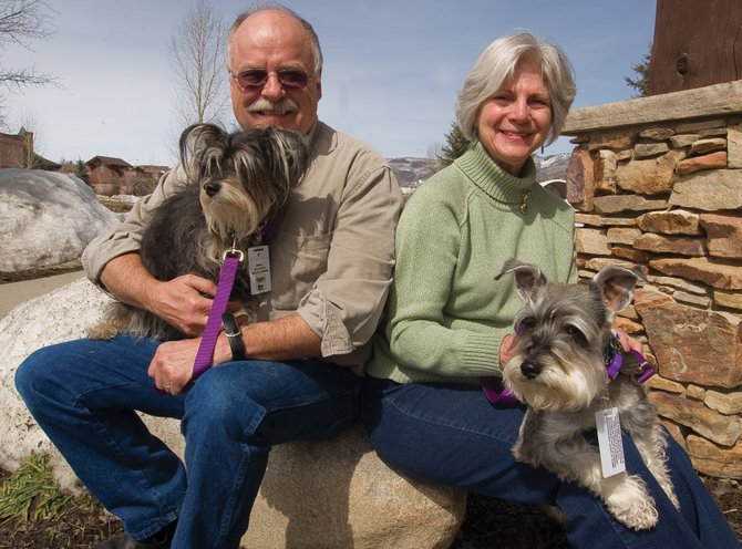 Bruce and Terry Hinde hold their pet schnauzers Benji, left, and Dori. The dogs are part of the Yampa Valley Medical Center's  Heeling Friends program through which dogs visit patients at the medical center.