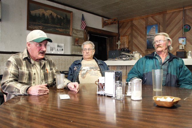 "L.D. ""Smitty"" Smith, from left, Jerry Jeffrey and Dick Blakley discuss hopes for their town Friday at the B&B Café in Dinosaur. Smith is the sole candidate to be the town's mayor in the upcoming April election. Jeffrey and Blakley are running for town council positions, also unopposed."