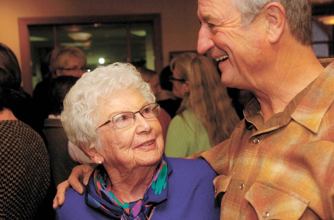 Longtime Steamboat Springs volunteer and public official Carol Booth Fox talks with friend Paul Stettner on Nov. 11, 2008, at a reception in her honor at Centennial Hall. Fox died Wednesday at age 81.