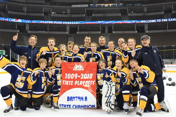 Steamboat's Bantam A youth hockey team celebrates Sunday after winning the state championship in a thrilling 2-1 overtime game at the Pepsi Center in Denver. 