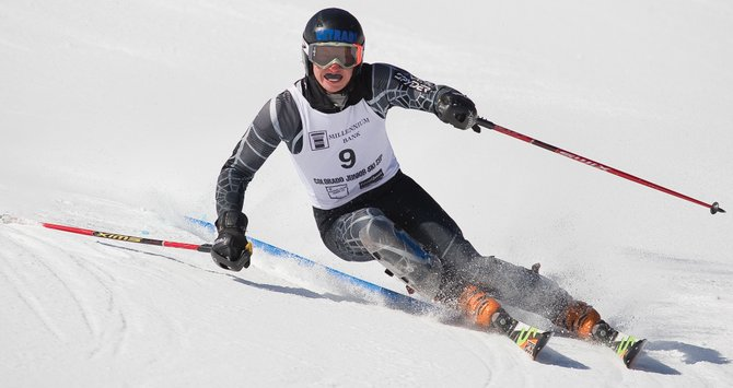 Steamboat Springs ski racer James Schindler pushes a gate out of the way during his second run of Monday's Millennium Bank Colorado Junior FIS Ski Cup Championships at Howelsen Hill. Schindler won all four events in this weekend's championships including the finale on Monday.