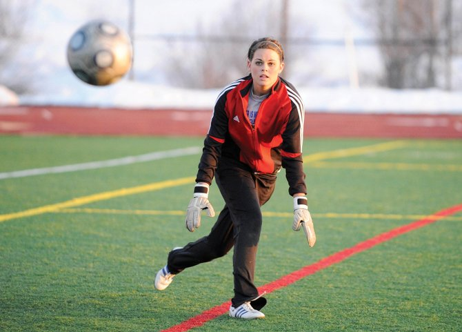 Steamboat Springs High School goalie Molly Moore, a junior, tracks the ball during practice Wednesday.
