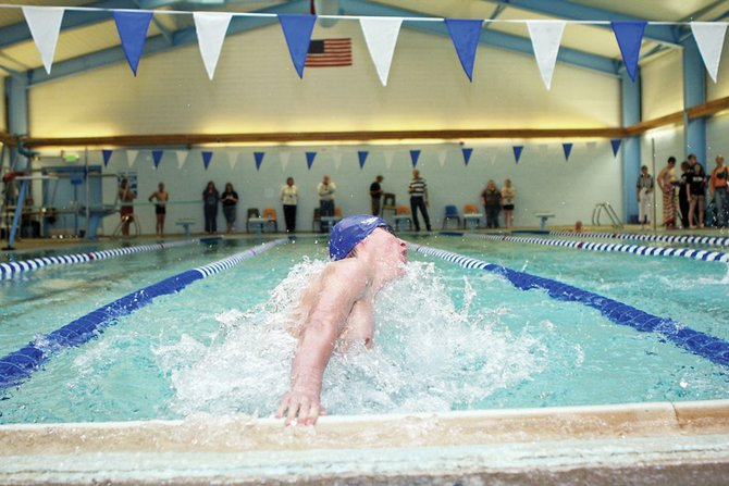 Moffat County High School freshman Matt Hulstine touches the wall during the individual medley race Friday at the MCHS swimming pool. Hulstine won the event with a time of 2:37.80.