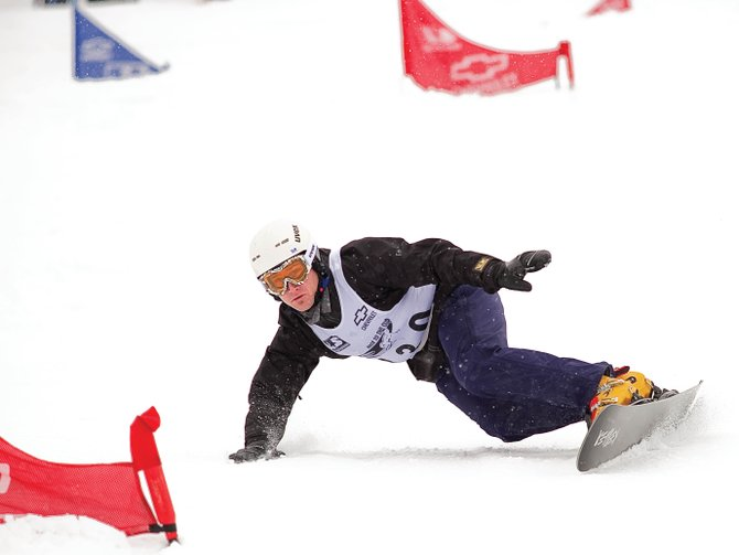 Tyler Jewell, who trained in Steamboat Springs leading up to the 2006 Olympics in Italy, speeds past a gate in Friday's Race to the Cup parallel giant slalom race at the Steamboat Ski Area. Jewell topped the field of the NorAm-level event, which was also used to crown the U.S. national champion. It was Jewell's second national title. The Alpine snowboarding Race to the Cup event will continue Saturday with the parallel slalom event, which will begin at 10 a.m. at the Steamboat Ski Area.