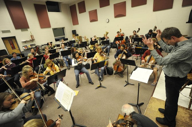 The Steamboat Symphony Orchestra practices Thursday at the high school. The orchestra's season finale is at 5 p.m. Sunday at the Strings Music Pavilion.