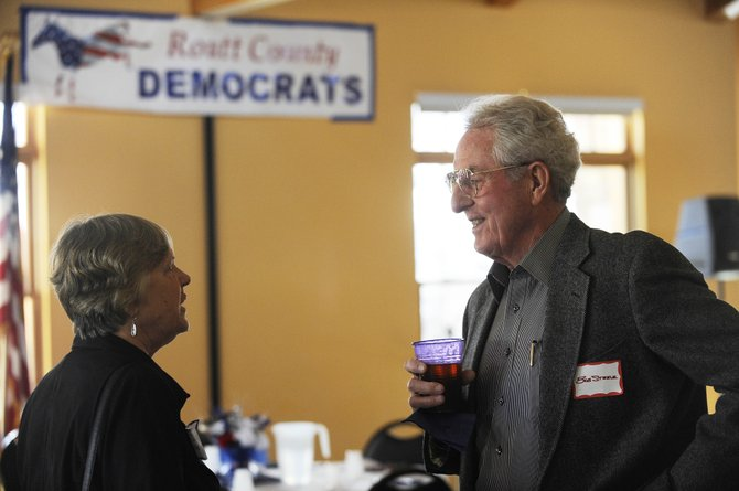 Routt County Democrats Bob Steele and Diane White-Crane visit during the Routt County Democratic Party's annual Jefferson-Jackson Potluck Dinner and Fundraiser on Saturday at the Steamboat Springs Community Center.
