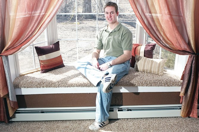 Kevin Oxley sits in the living room of his Victorian-style home on the 1500 block of Yampa Avenue. Oxley is a manager of TLC Carpet One and has lived in Craig most of his life.
