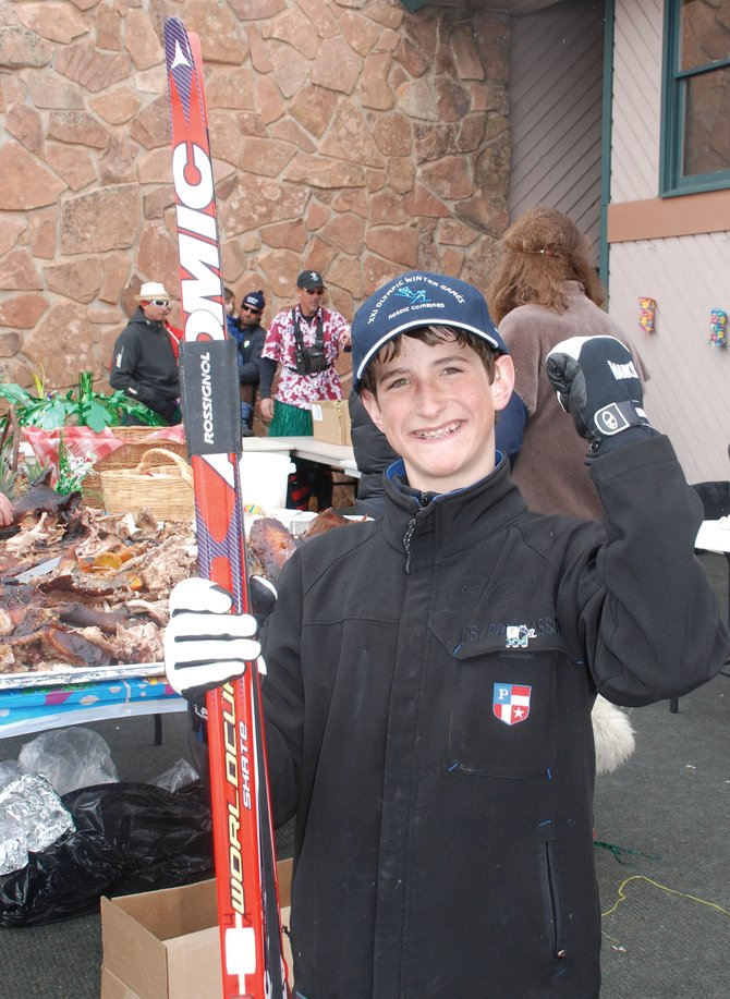 Steamboat Springs Winter Sports Club Nordic combined skier Grant Andrews, 12, scored a pair of Olympic silver medalist Johnny Spillane's skis in a raffle at the ninth annual Hakan Memorial Nordic Fest at the Steamboat Ski Touring Center on Saturday. The event raised more than $2,000 to support young Nordic skiers.
