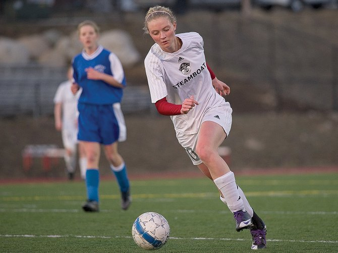 Steamboat Springs Kiersten Henry drives toward the goal in the second half of Monday night's game against Moffat County. Henry had two goals in the game as Steamboat rolled to a 8-0 victory against Moffat County at Gardner Field.
