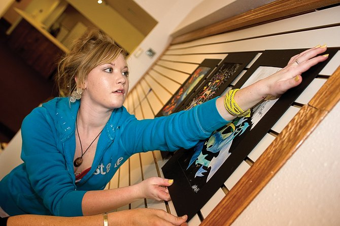 Steamboat Springs art student Sophie Myller was busy hanging her art earlier this week at the downtown Steamboat Springs Center for Visual Arts. The gallery has invited art students from the high school to take part in a show, which opens today.