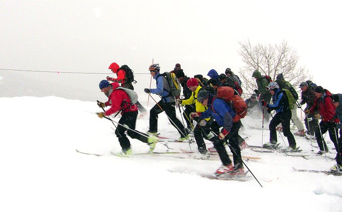 Racers pull away from the starting line near the top of the gondola Saturday morning in the Cody's Challenge Randonee race at Steamboat Ski Area. The race served as a fundraiser for the Cody St. John Foundation, which provides scholarships to ski patrollers working on a career in medicine.