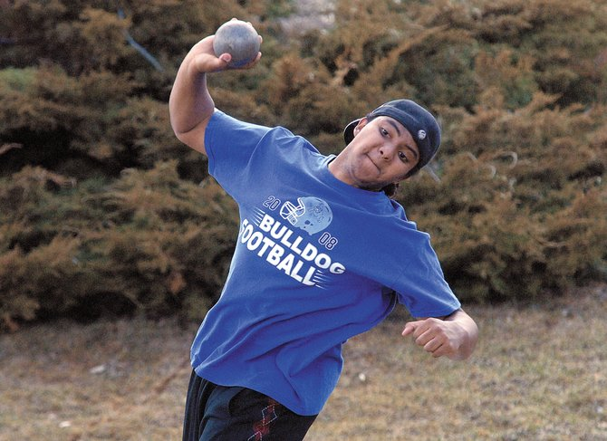 Moffat County High School junior Casey Martin throws the shot put Monday during Moffat County High School track and field team's practice. Martin and the rest of the MCHS team will compete Saturday in Grand Junction.