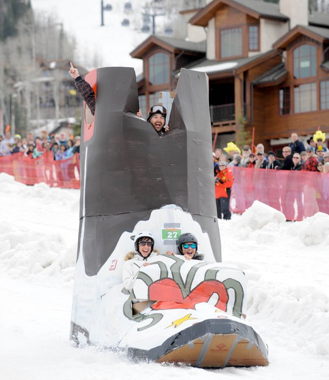 Jamie Curcio peaks out from the top of his group's cardboard boot while Carrie Good, left, and Kerrie Holmes take a seat in the front during last year's Cardboard Classic at Steamboat Ski Area.
