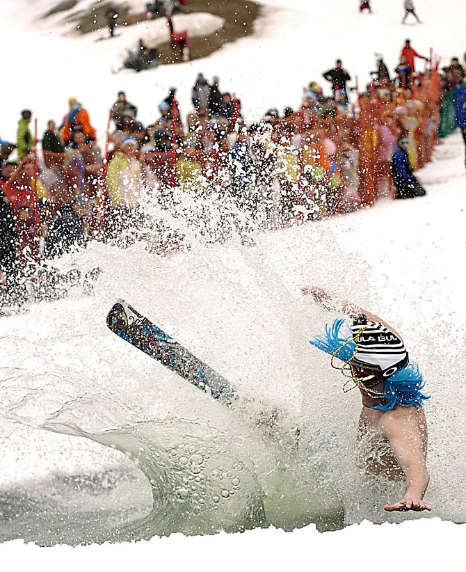 Ryan Armento takes a cold dip last year at the pond-skimming competition at Steamboat Ski Area.