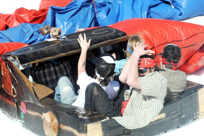 "The ""El Camino Loco"" cardboard craft crashes into a barrier at the end of the run at Saturday's 30th annual Cardboard Classic event at the Steamboat Ski Area. The craft won an award for being the most creative."