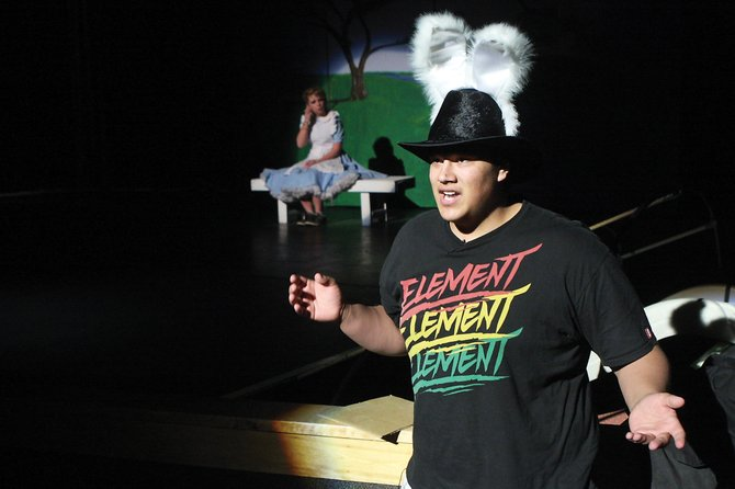 The White Rabbit, junior Tucker Trujillo, runs around the stage frantically, late for an important date, during play rehearsal Thursday at the Moffat County High School auditorium
