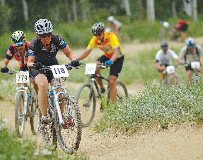 Jody Gale leads a long train of bikers up Mount Werner as a part of the Thunderhead Hill Climb Town Challenge mountain bike race in July 2008. The ski area Thursday announced plans for a massive overhaul of its trail system.