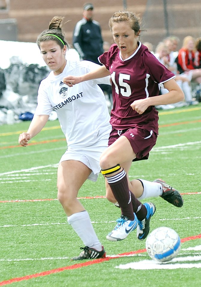 Palisades Flannery Davis pushes aside Steamboats Hope Scott on Saturday. Steamboat lost the game, 1-0.