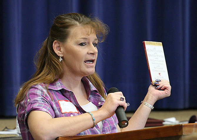 Tami Barnes, a candidate for Moffat County Commission District 2, holds a copy of the U.S. Constitution during the Moffat County Republican Party County Assembly on Saturday at Sandrock Ridge Elementary School. Barnes received seven of the 86 delegate votes, which eliminated her from being placed on August's primary ballot.
