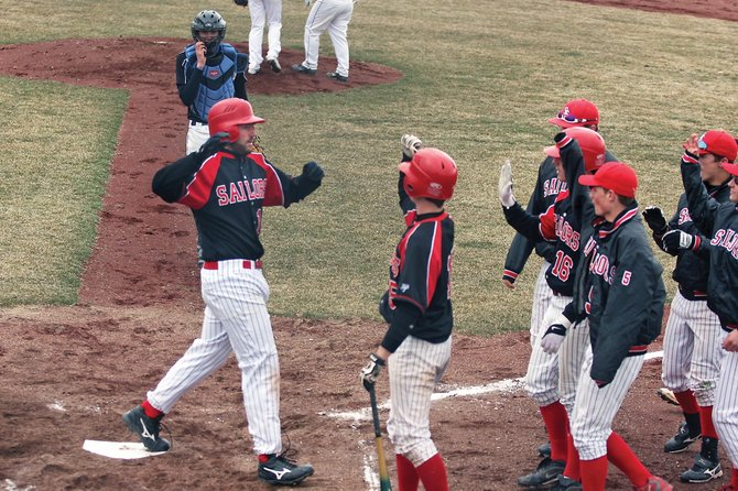 Matt Watwood crosses the plate to high-fives from his teammates after hitting a second-inning home run Tuesday against Moffat County High School. The Steamboat Springs High School baseball team lost to Moffat County, 15-7.