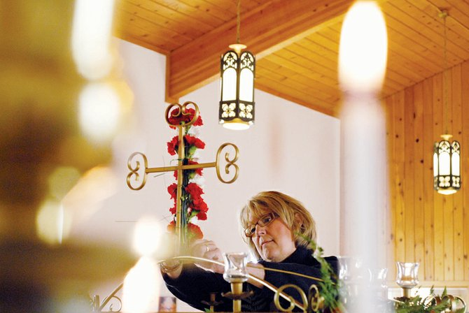 Marianna Raftopoulos, pictured here arranging flowers in St. John the Baptist Greek Orthodox Church during holy week in 2008, died Wednesday at her home. She was known in the Craig community as a former Moffat County Commissioner, board member for many organizations, mother to three and oil and gas lobbyist. Funeral services are pending with Grant Mortuary.