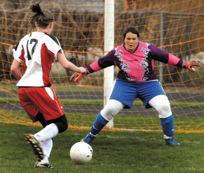 Moffat County's Imelda Hernandez prepares to block a shot Tuesday in Glenwood Springs. The Moffat County High School girls varsity soccer team fell, 5-0, to the Demons. Moffat County's varsity team will play at 4 p.m. today with the junior varsity playing at 6 p.m. against Palisade at Woodbury Sports Complex.