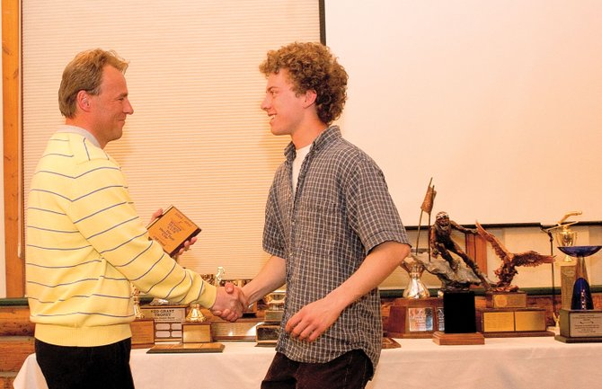 Nordic combined coach Martin Bayer presents Cliff Field with the Henry Hall Cup at Wednesday night's Steamboat Springs Winter Sports Club's Awards Ceremony. The club handed out more than 20 awards at the ceremony, which was held at Olympian Hall.