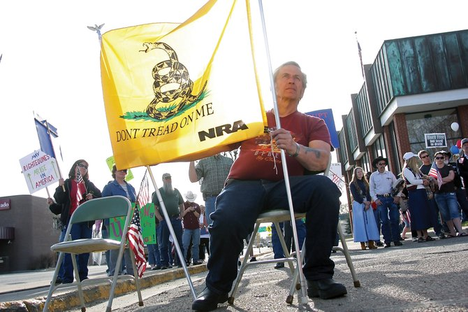 Willard White displays the Gadsden flag during a Moffat County tea party tax day protest Thursday in front of the Moffat County Courthouse. Supporters came from as far as Meeker to attend the event.