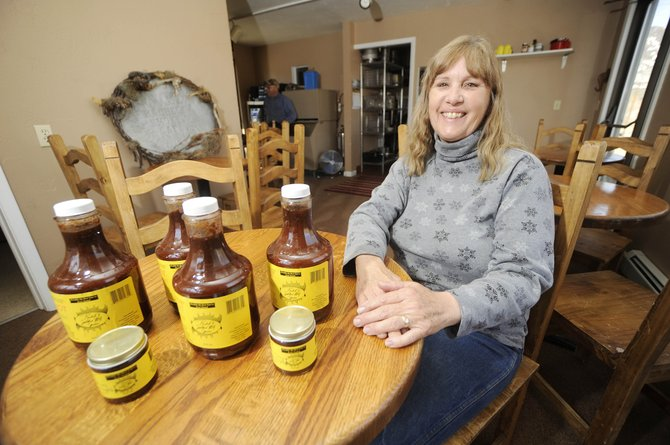 Rachel Green, creator of Oak Creek-based Rachel's Smokin' BBQ sauce, is opening a barbecue restaurant in Oak Creek that will feature her sauce.