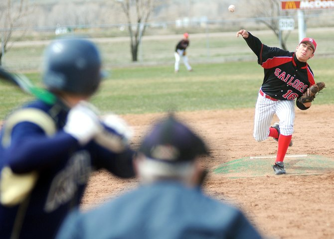 Steamboat Springs High School's Tyler Brown pitches in the first game of a doubleheader Saturday in Craig. Steamboat lost the first game to Rifle, 15-3, but bounced back to win the second, 6-3.