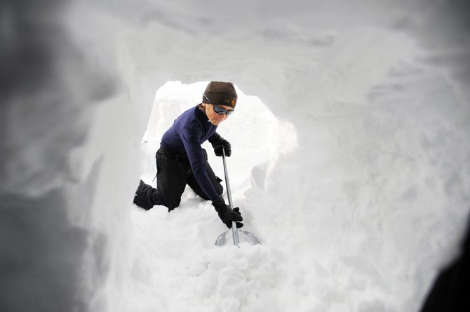 Steamboat Springs Middle School seventh-grader Spencer Petersen digs out from the base of an igloo last weekend during an Everything Outdoor Steamboat overnight camping trip on Rabbit Ears Pass.