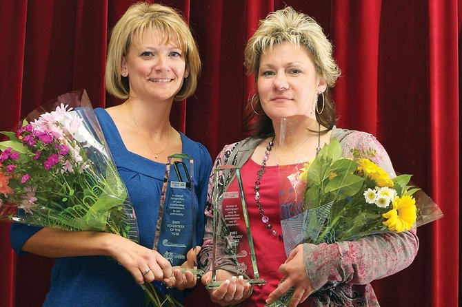 Lynnette Running, left, and Renae Virden were named the Moffat County United Way 2009 Volunteers of the Year at an annual luncheon Tuesday at the Moffat County Fairgrounds Pavilion. The pair volunteered a combined 2,500 hours last year as Advocates-Crisis Support Services board members.