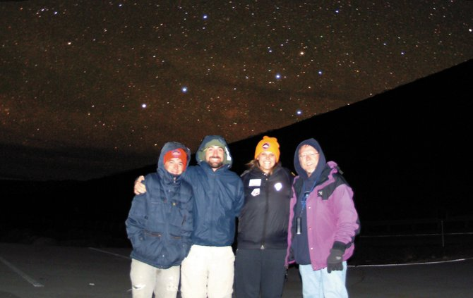 On a recent trip to the Big Island of Hawaii, Colorado Mountain College astronomy professor Jimmy Westlake, right, and students, from left, David Edelman, Todd Campbell and Mollie Wunder took a moment off from their sunset-to-dawn Messier Marathon on Mauna Kea, the world's tallest mountain, to pose beneath the stars of the Southern Cross, visible just above Westlake's head.