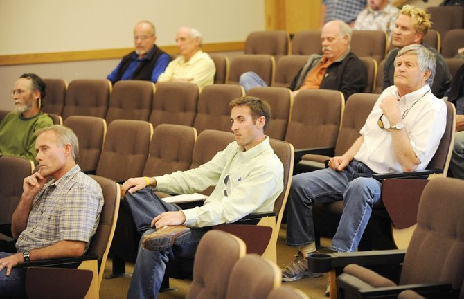 Native Excavating owner Ed MacArthur, from left, Connell Resources construction manager Eric Marsh and Duckels Construction owner Fred Duckels listen Tuesday to Steamboat Springs City Council members discuss a disputed $4.5 million contract for base area construction.