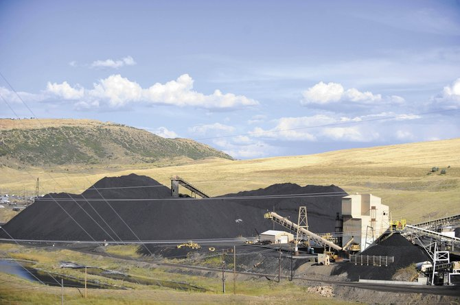 Colorado House Bill 10-1365, also known as the Colorado Clean Air-Clean Jobs Act, was signed into law Monday. State Sen. Al White said the law could result in a loss of 200 coal jobs at Routt County's Twentymile coal mine.