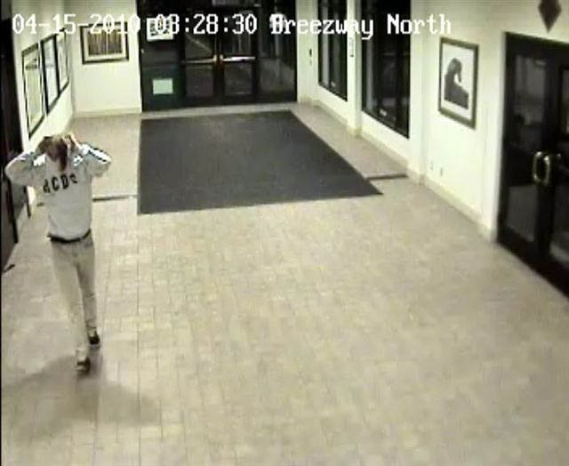 Surveillance footage shows a person walking out of the Sheraton Steamboat Resort from the April 15 theft of a photograph at the hotel.