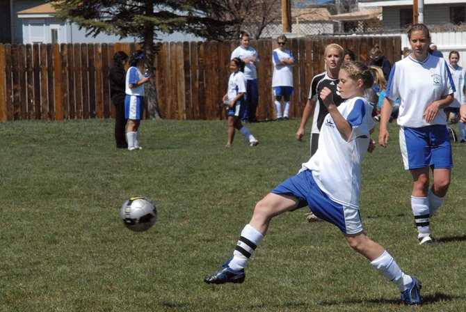 Amanda Brewer kicks the ball out of Moffat County High School territory Saturday against Eagle Valley. The Bulldogs were able to best the Devils, 4-0, at Woodbury Sports Complex.