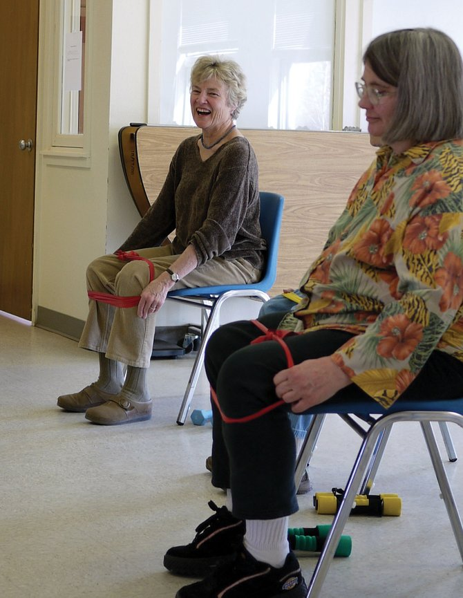 Renata Burgess, left, shares a laugh with Pat Crawford and other participants in the Arthritis Foundation exercise class held at the South Routt Community Center on Mondays.